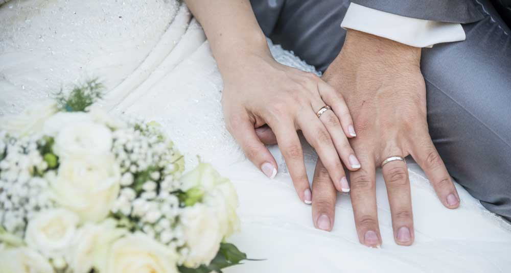 couple with matching rings